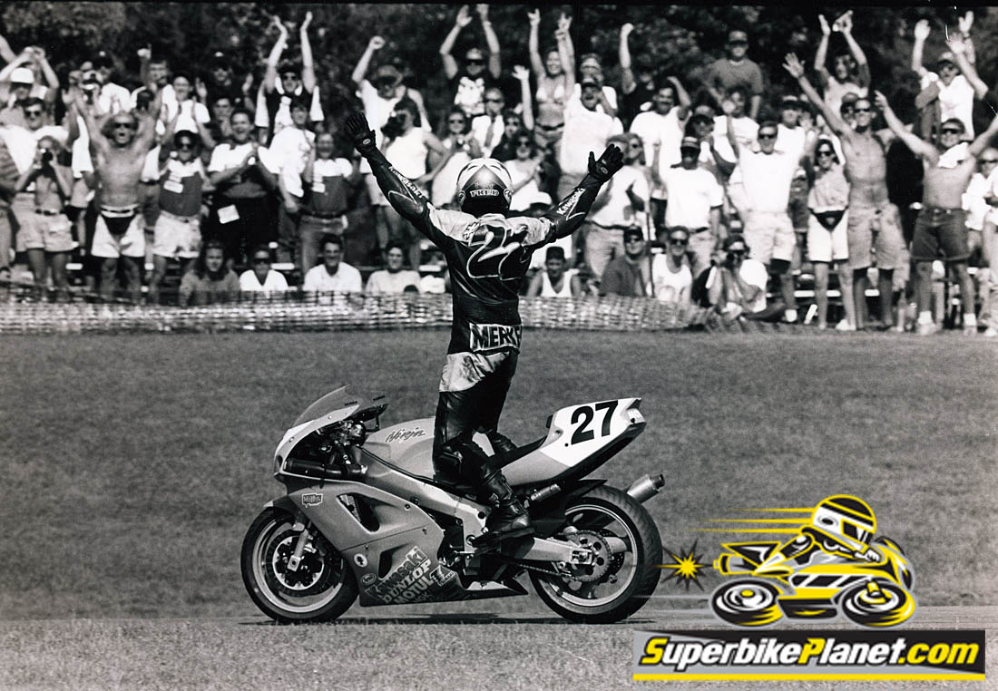 Kawasaki's Fred Merkel celebrates with the Brainerd crowd after a 750 Supersport win at the Minnesota track during the summer of 1994.