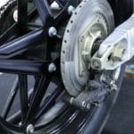 """Bolt-together Honda rear wheel, large rear disc and conventional swing arm. It sounds like a joke but isn't: HRC recommended """"Golden Cruiser"""" brake fluid in all race brakes at the time."""