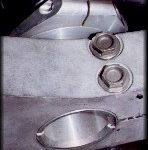 The lower triple clamp and steering head.