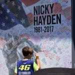 A young fan signs the Hayden memorial cloth.
