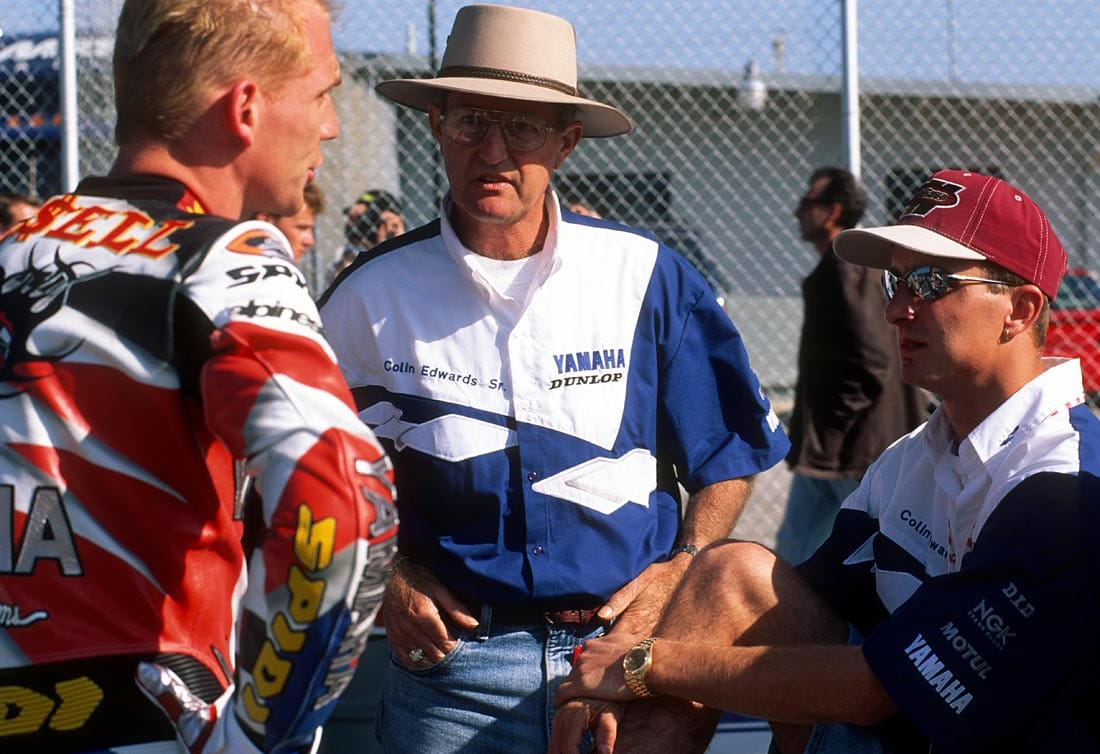 Colin Edwards Sr and II speak with Scott Russell at Daytona in 1998.