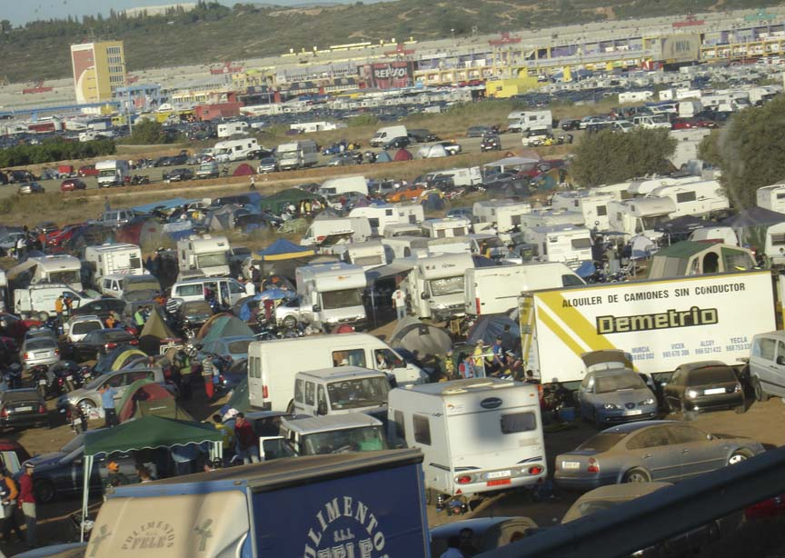 Time to shake off the hang-over and hit the track. Tents litter the hillside.