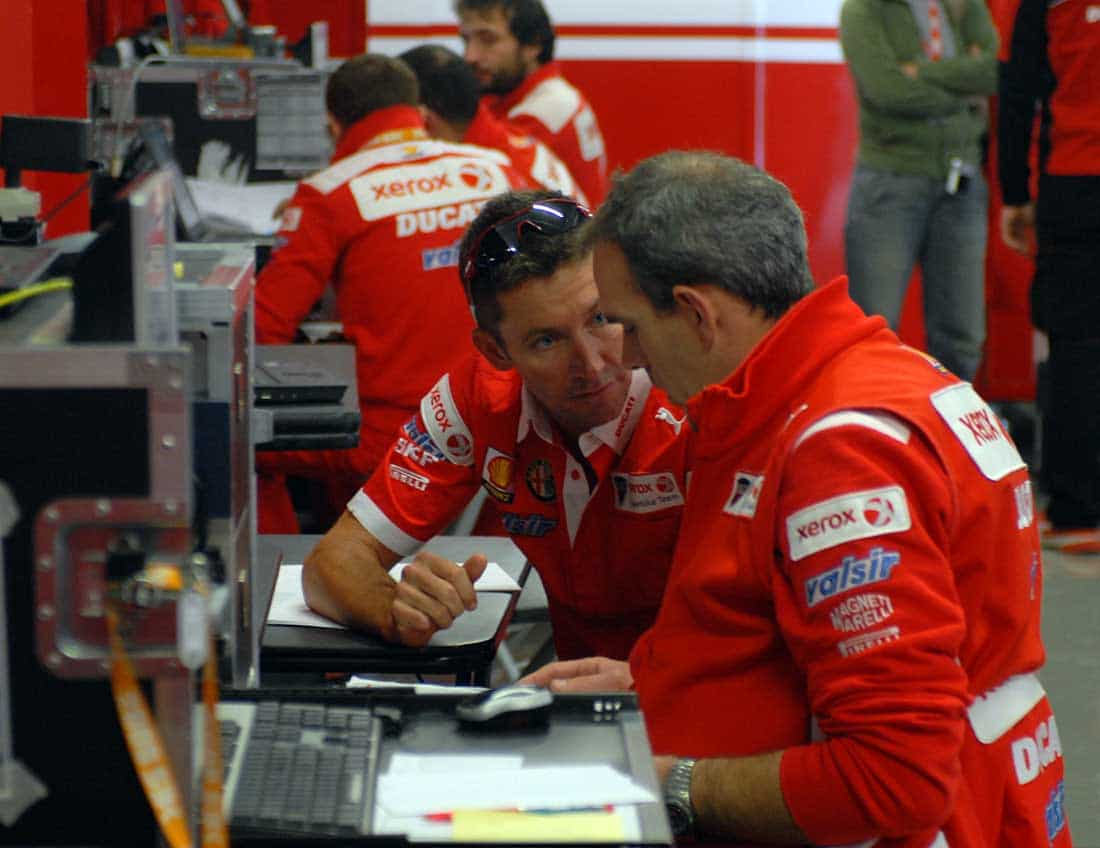 Ducati Corse Superbike boss Ernesto Marinelli (right) and Troy-tastic. Probably Portugal 2008.