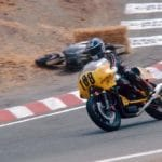 Fred Eiker on his 'Guzzi with a fellow competitor on the side of the track.