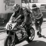 The late Merlyn Plumlee gives the factory Yamaha YZF boat anchor of Tom Kipp a bump start.