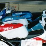 Pretty TZ250s all in a row...except, wait, look closely. That bike in the foreground is an ultra-rare-in-the-U.S. Yamaha TZR250R street bike, the infamous 'Kocinski Replica' that commemorated JK's 1990 250cc GP World Championship.