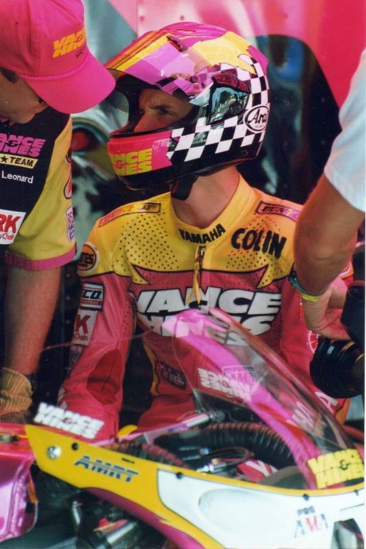 Resplendent in V&H Yamaha magenta, yellow, and black, Colin Edwards de-briefs with his crew chief Jim Leonard.