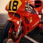 An early 1990s Cagiva 500, ridden either by Ron Haslam or Alex Barros. Note: tech sheet/entry form in windscreen.
