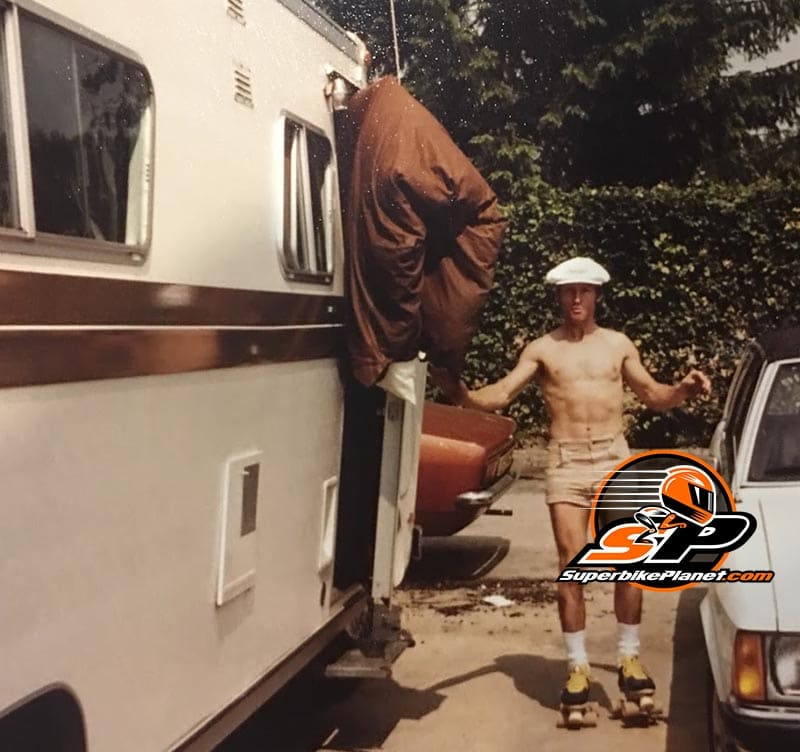 This is from one of the Match Races in the UK. Roberts in race day paddock garb. the motorhome was owned by Barry Sheene and Roberts wanted a picture as he had just made Sheene's awning look like a vagina that needed to be passed through in order to enter the motorhome. Never a dull moment.