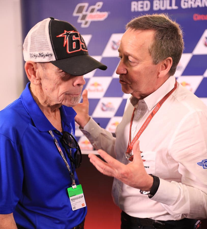 Earl Hayden talks with three-time world champion Freddie Spencer before the ceremony to retire Nicky's number 69.