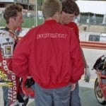 Fogarty ruminates with former rider Anders Anderson (back to camera) and his mechanic, Slick Bass.