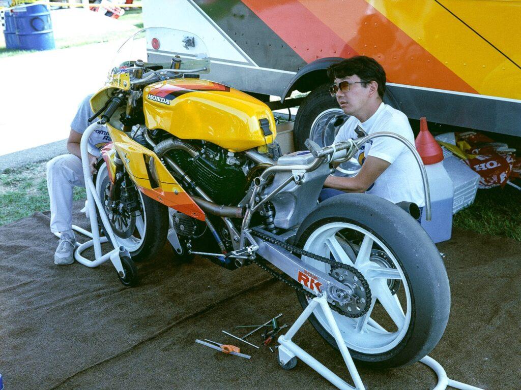 A younger Brian Uchida working on Martin Adams' famed RS-powered Twins bike.